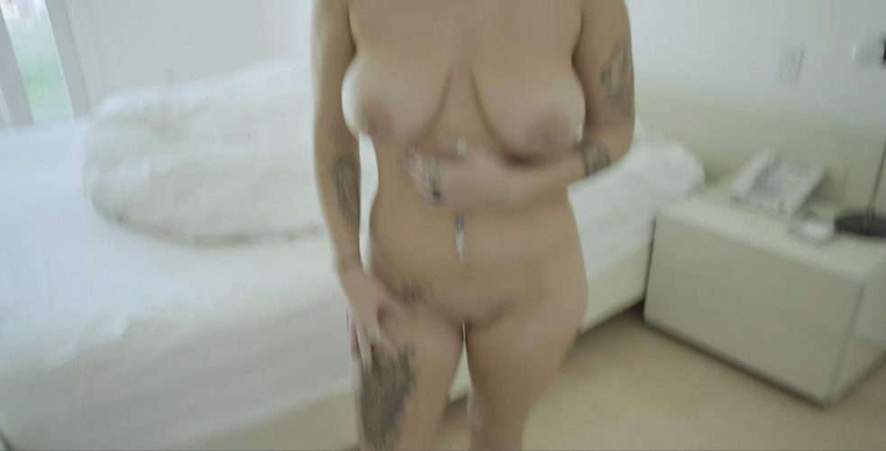 Curvy busty babe naked
